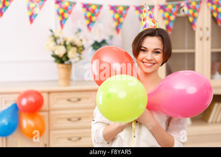 Young girl with colorful balloons - Stock Photo