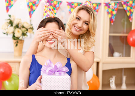 Girls having fun during birthday celebration. - Stock Photo