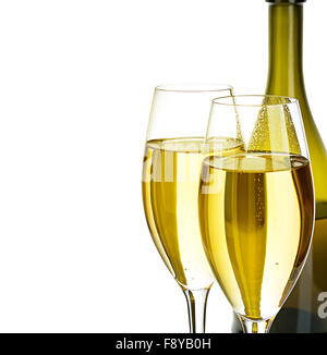 Two glasses of champagne on the background of brown bottles close-up isolated on a white. Festive still life. - Stock Photo