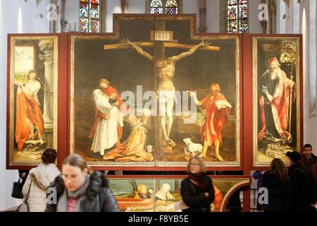 Colmar, France. 10th Dec, 2015. Visitors look at the Isenheim Altarpiece in the Dominican church at the Unterlinden - Stock Photo