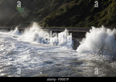 Waves breaking onto the promenade at Teignmouth - Stock Photo
