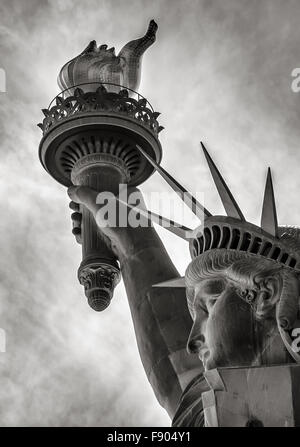 Black & White detail of torch, crown and profile of the Statue of Liberty, Liberty Island, New York City - Stock Photo