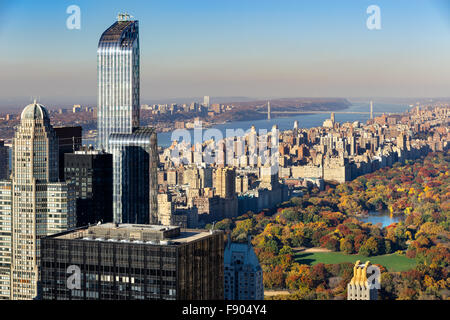 Aerial View of Central Park in Fall, Upper West Side with Midtown skyscrapers and the Hudson River, New York City. - Stock Photo