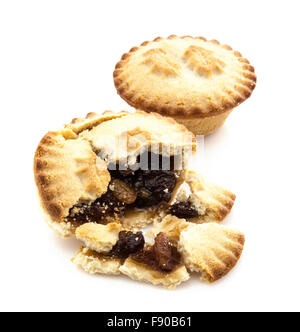 Mince Pie broken in half showing mince on white background - Stock Photo
