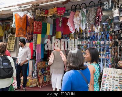 Tourists Shopping In Textile Market Souk In Dubai