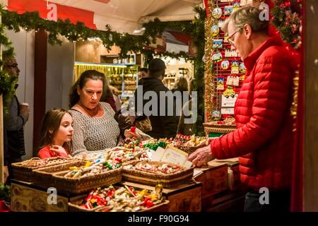 People shop at the Columbus Circle Holiday Market in New York, the United States on Dec. 11, 2015. The annual Columbus - Stock Photo