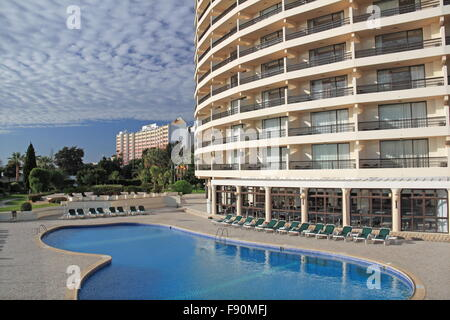 Main swimming pool at Hotel Vila Galé Ampalius, with Alameda Praia da Marina, Vilamoura, Quarteira, Algarve, Portugal, - Stock Photo