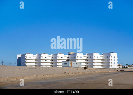 bare white condominium building under construction a block from beach at Playa las Conchas, planned development - Stock Photo