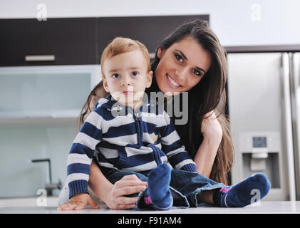 portrait of a happy mom and son together in modern living room home indoor - Stock Photo