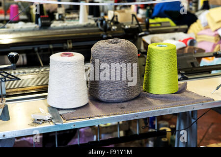 Detail of Three Industrial Size Spools of Cotton Thread in Variety of Colors in Industrial Manufacturing Warehouse - Stock Photo