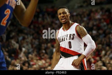 Portland, Oregon, USA. 12th December, 2015. DAMIAN LILLARD (0) reacts to his dunk. The Portland Trailblazers hosted - Stock Photo