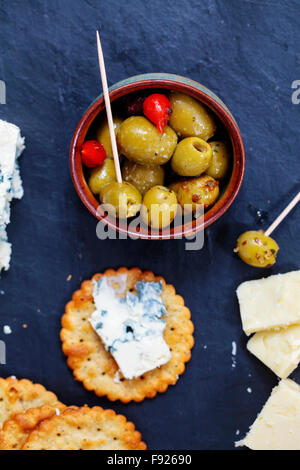 Olives, cheese and biscuits - Stock Photo