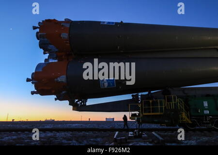 BAIKONUR, KAZAKHSTAN. DECEMBER 13, 2015. A Soyuz FG rocket booster with the Soyuz TMA-19M spacecraft being transported - Stock Photo