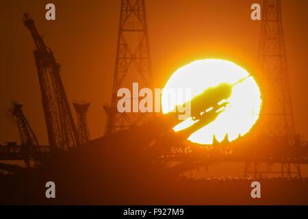 BAIKONUR, KAZAKHSTAN. DECEMBER 13, 2015. A Soyuz FG rocket booster with the Soyuz TMA-19M spacecraft being installed - Stock Photo