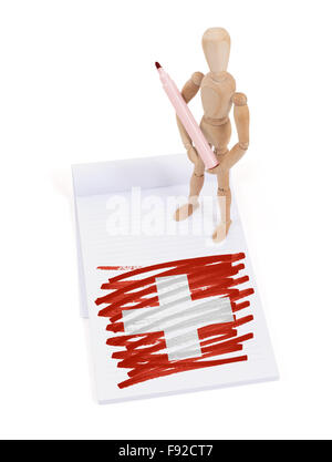 Wooden mannequin made a drawing of a flag - Switzerland - Stock Photo
