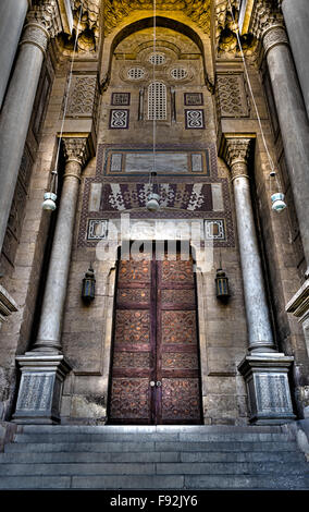 Ornamented wooden door of an old mosque in old Cairo, Egypt, named Royal Mosque dates from around 1361 - Stock Photo