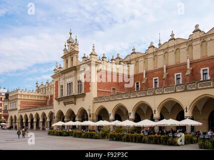 13th century Sukiennice (the Cloth Hall or Drapers' Hall) with restaurant in main Market Square (Rynek Glowny) Krakow - Stock Photo