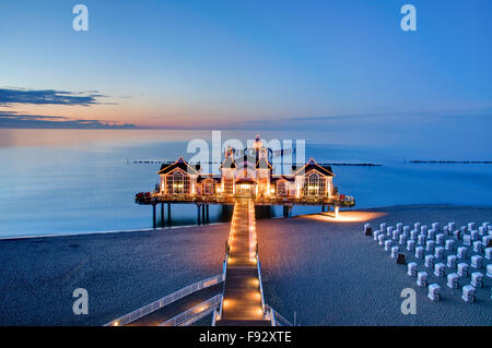 Beautiful pier with restaurant in Sellin, Baltic Sea, Germany, in the evening - Stock Photo