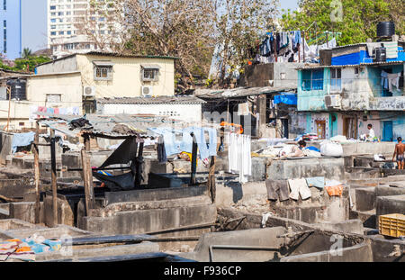 Dhobi Ghat, a well-known, large, open air laundromat in Mumbai, India on a sunny day with blue sky - Stock Photo