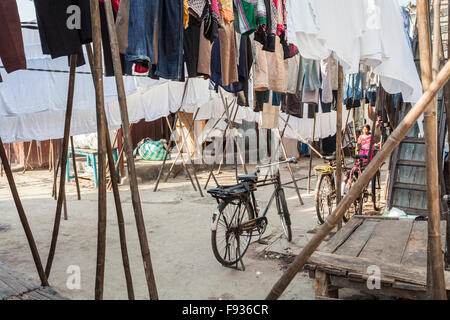 A bicycle and clothes drying at Dhobi Ghat, a large open air laundromat in Mumbai, India - Stock Photo