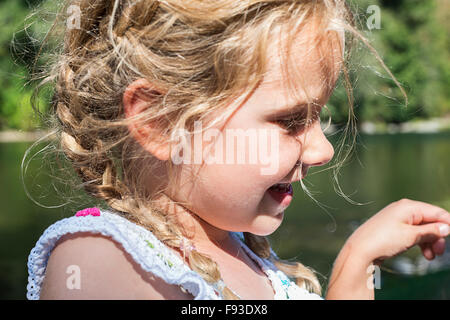 Little girl near a river - Stock Photo