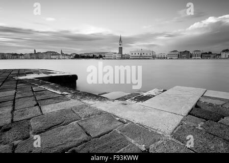 A classic black and white Venice scene; looking towards Piazza San Marco from across the lagoon at San Giorgio Maggiore. - Stock Photo