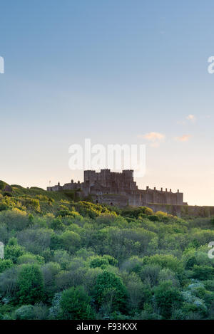 Last light on Dover Castle and surrounding woodland. Kent, England. - Stock Photo