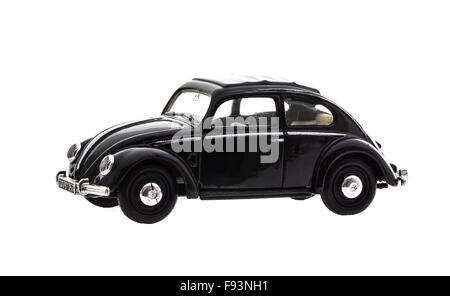 VW Beetle in Black Die cast model on a white background. - Stock Photo