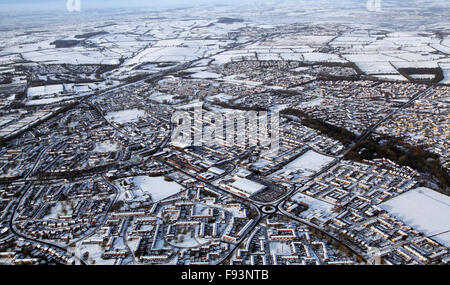 aerial view of a snowy English scene, town and countryside, UK - Stock Photo