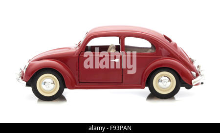 VW Beetle in Red, Die cast model on a white background. - Stock Photo