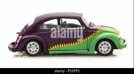 VW Beetle With Zip Paint Die cast model on a white background. - Stock Photo