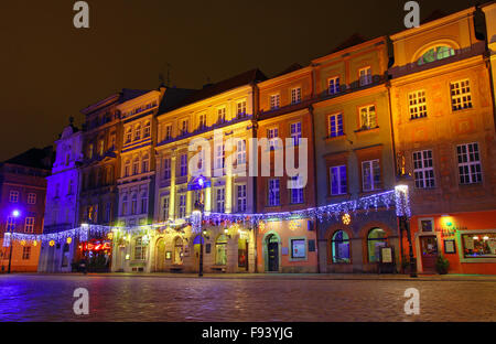 Night view of houses in Old Market Square in Poznan, Poland - Stock Photo