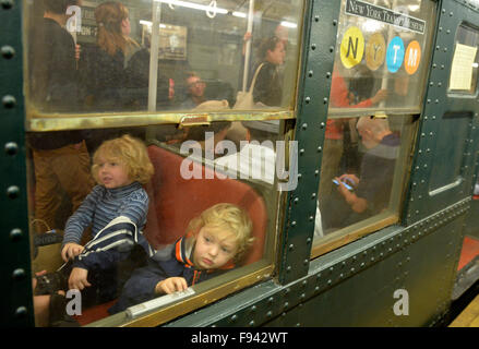 New York, USA. 13th Dec, 2015. Children experience antique cars at a subway station in New York City, the United - Stock Photo