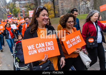New York, NY 13 December 2015 Several hundred Families, advocates and Survivors wear orange for the Orange Walk - Stock Photo