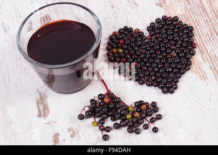 Heart Shaped Fresh Elderberry On Old Rustic Wooden Background