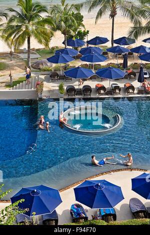 Upscale resort pool and beach area. Klong Muang Beach, Krabi Province, Thailand. - Stock Photo