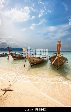 Traditional longtail boats moored at the beach on Poda Island (Koh Poda). Krabi Province, Thailand. - Stock Photo
