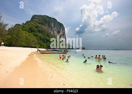 Tourists bathing in Andaman sea at the bech on Poda Island (Koh Poda). Krabi Province, Thailand. - Stock Photo