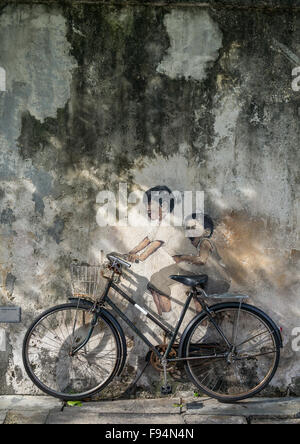 Children On Bike Street Arwotk By Lithuanian Artist Ernest Zacharevic, Penang Island, George Town, Malaysia - Stock Photo