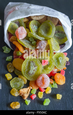 Candied dried mixed assortment of exotic fruits in the bag - Stock Photo