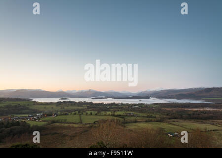wide angle view of loch lomond and the snow covered peaks of the Southern Highlands, including Ben Lomond in winter - Stock Photo