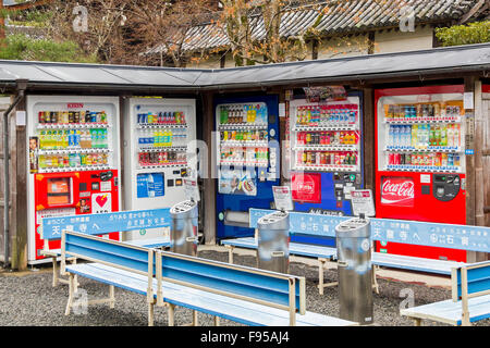 Traditional outdoor vending machines to sell various drinks and snacks and smoking place in Kyoto - Stock Photo