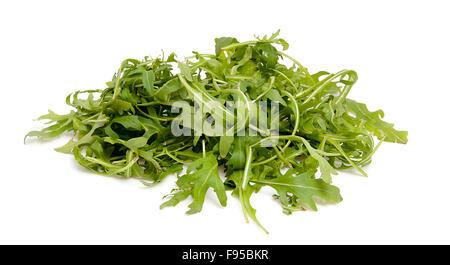 Pile of fresh Ruccola lettuce over white background - Stock Photo