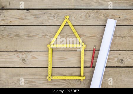 house concept with yellow meter on wooden floor - Stock Photo