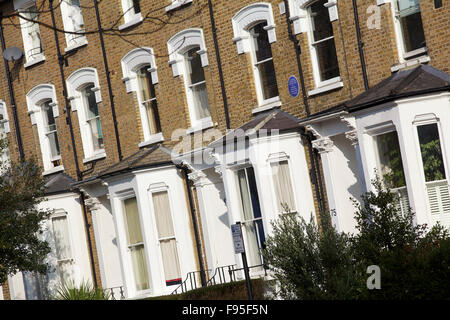 Hammersmith, London. Angled view of row houses in a residential street in Hammersmith. Bay windows. Brick used on - Stock Photo