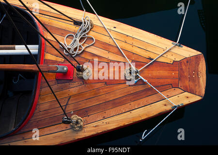 View from above of the bow of a small wooden sail boat. - Stock Photo