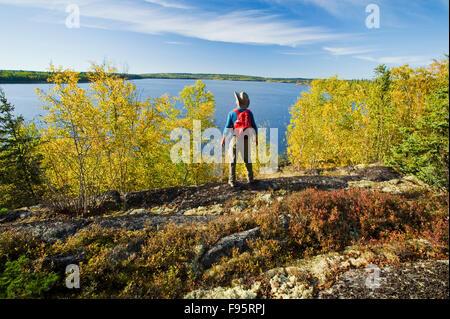 hiker looking out over Devil Lake, Northern Saskatchewan, Canada
