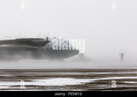 A Royal Canadian Air Force Lockheed Hercules aircraft in a blizzard in Iqaluit, Nunavut, Canada - Stock Photo