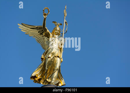 Golden Statue atop the Victory Column or  Siegessaule, Designed by Heinrich Strack, Berlin, Germany - Stock Photo