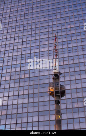 Fernsehturm or Berlin TV Tower reflected in buildings at Alexanderplatz in Berlin, Germany - Stock Photo